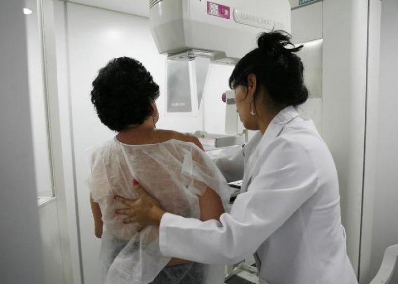A woman undergoes a free mammogram inside Peru